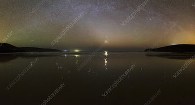 Starlight reflected in a bay at night