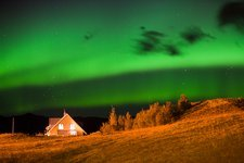 Northern lights over a house