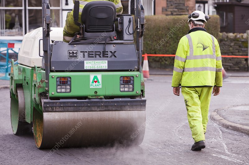 Workmen replacing road surface