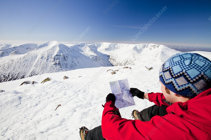 Mountaineer checking his map