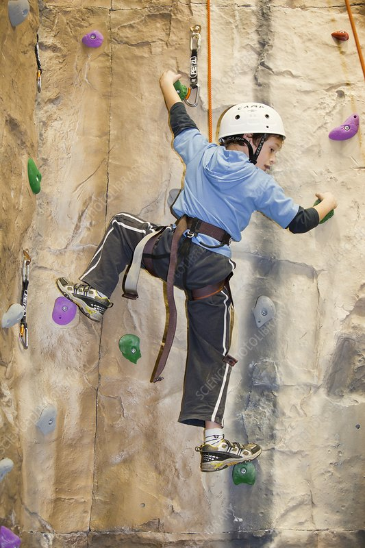 Young boy on a climbing wall