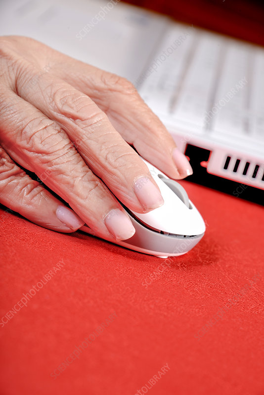 Elderly woman using a computer mouse