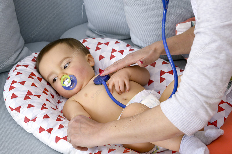 Baby boy being examined by a doctor