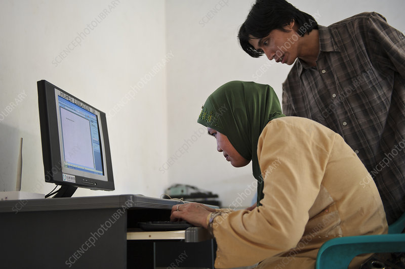 Visually impaired woman using computer