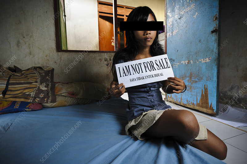 Girl with sign, Indonesia