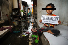 Child with sign, Indonesia