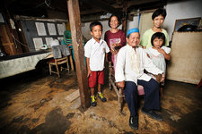 Man with leprosy, and family, Indonesia