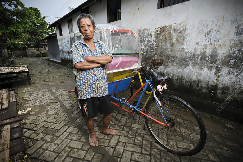 Rickshaw driver with leprosy, Indonesia