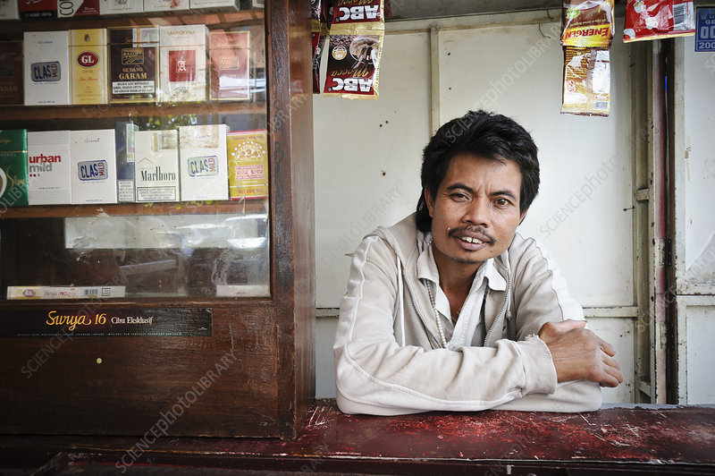 Shopkeeper with leprosy, Indonesia