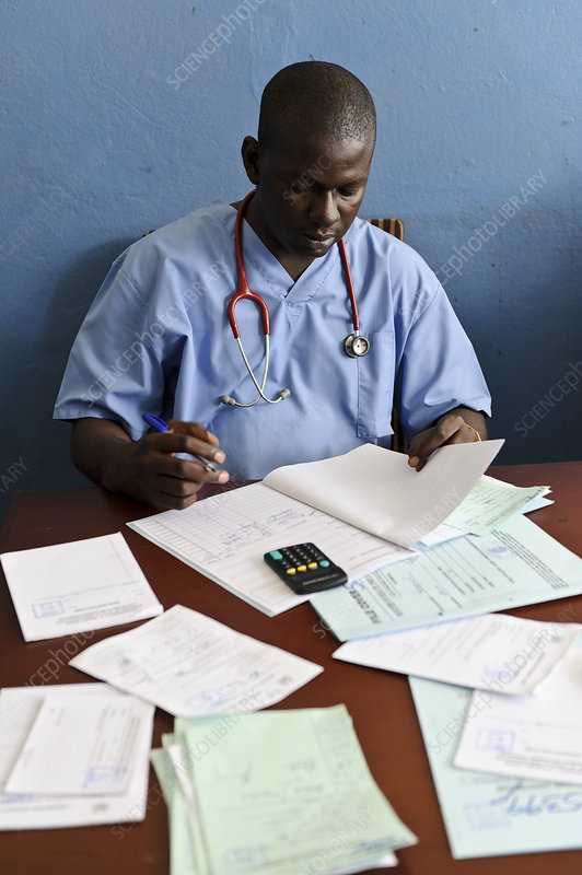 Doctor with patient notes, Sierra Leone