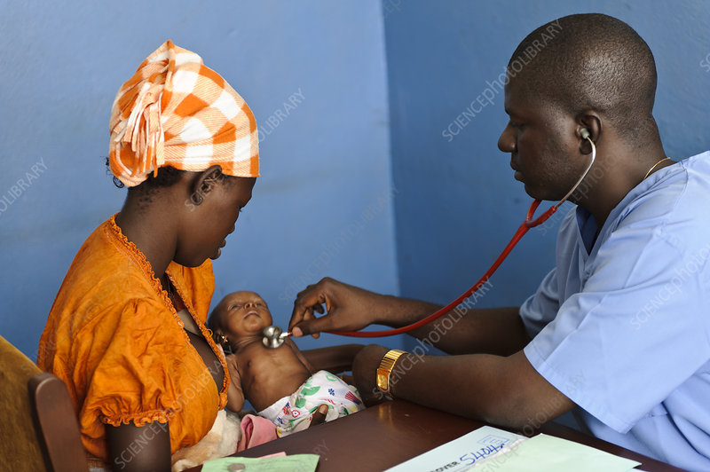 Doctor examining a baby, Sierra Leone