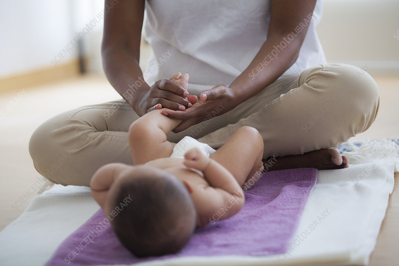 Infant being massaged