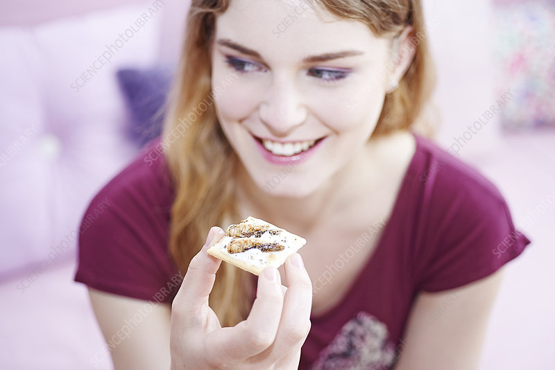 Woman eating insect