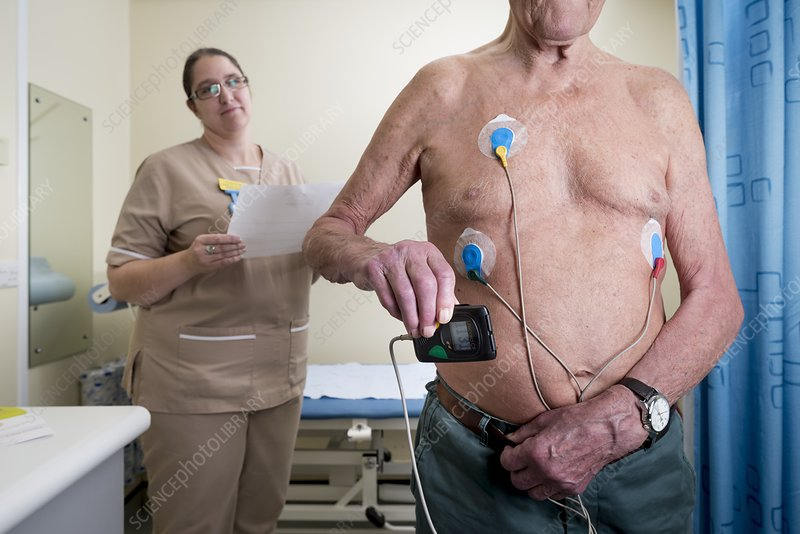 Portable ECG monitor being fitted - Stock Image - C027/2813