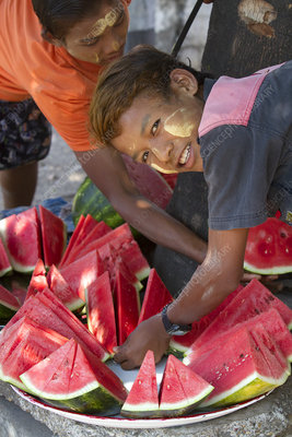 Street Vendors Selling Sliced Watermelon