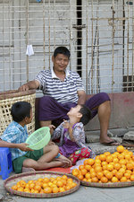 Burmese Father and Sons Selling Oranges