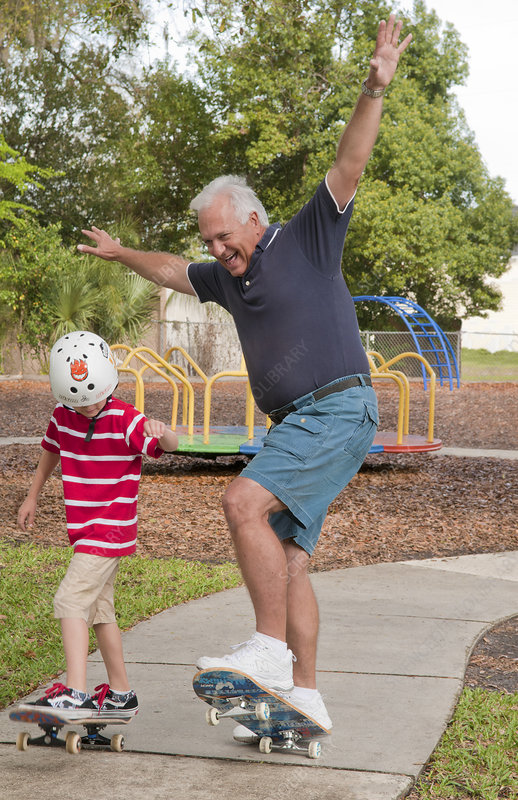 Grandfather and Grandchild Skateboarding