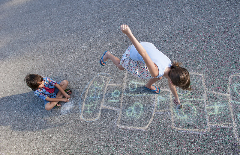 Young Girl Playing Hopscotch on Pavement