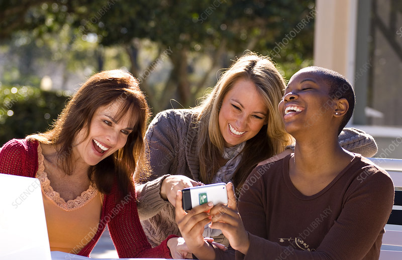 Women Laughing and Looking at iPhone