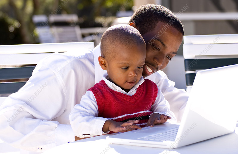 Father and Boy Playing with Computer
