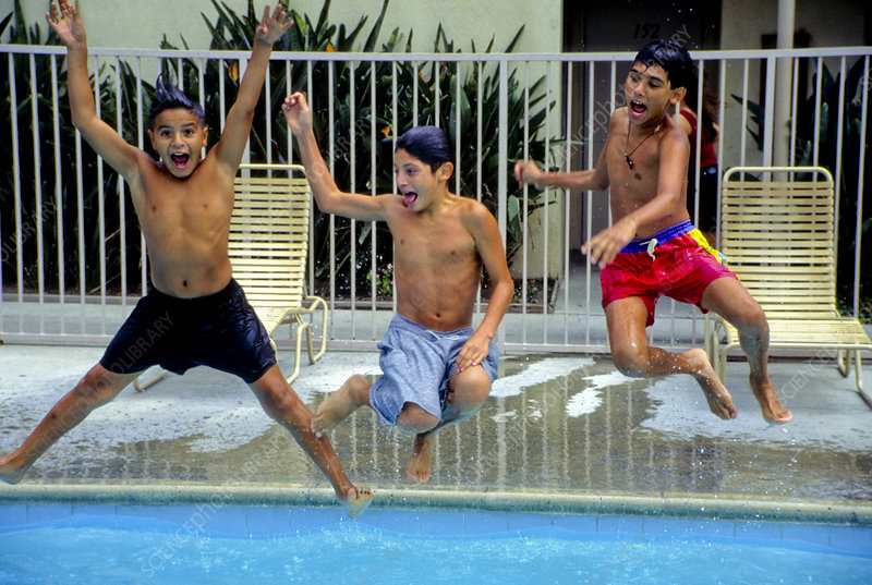 Boys Jumping into Pool
