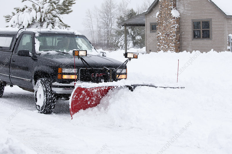 Plowing Through Winter Snowstorm
