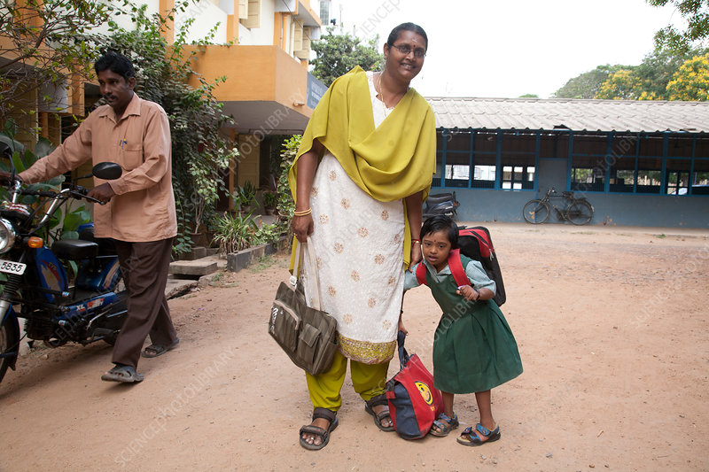 Mother Brings Daughter to School, India