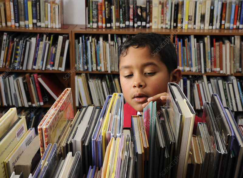 8 Year Old Boy in Library