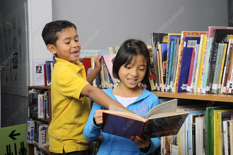 8 Year Old Boy and Girl in Library