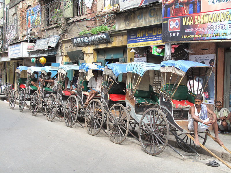 Rickshaw in centre of city, India