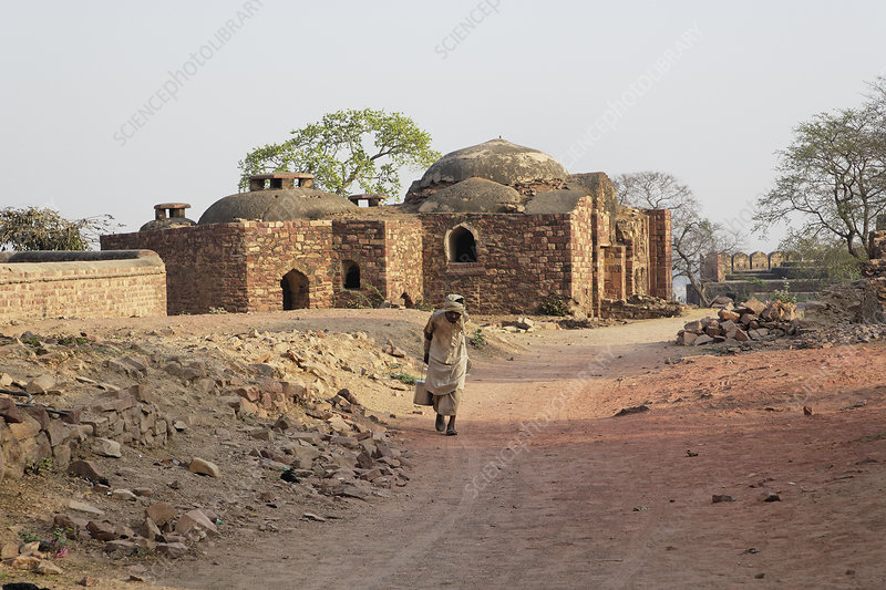 Man Walking on Dirt Road, India