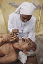 Missionary Treating Leper, India, 1980s