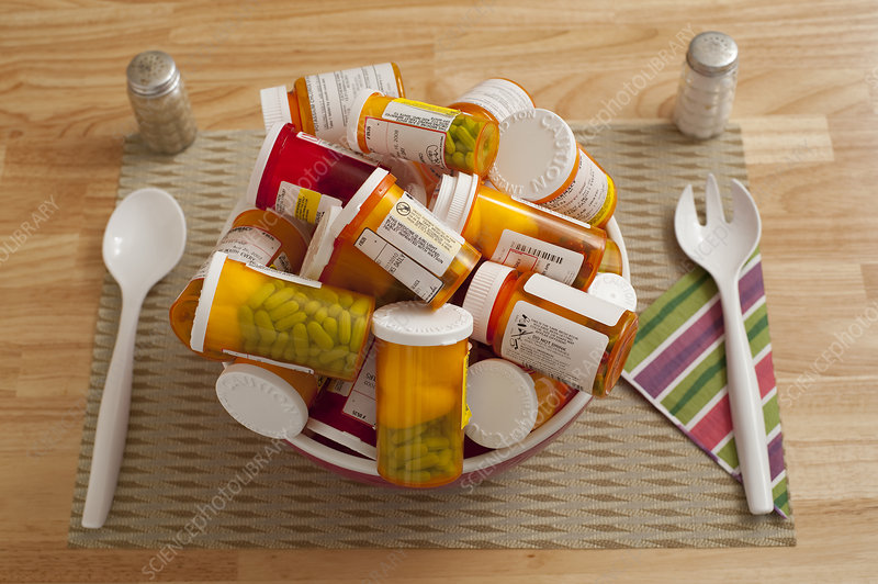Bowl Filled with Pill Bottles on Table