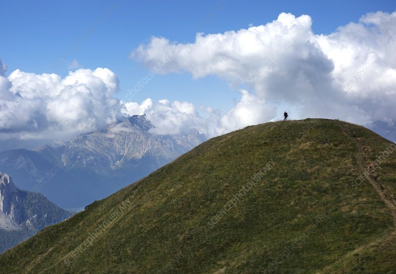 Couple on hilltop in the Dolomites, Itlay