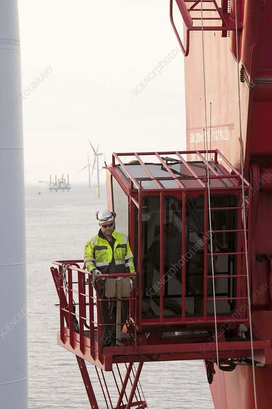 A crane operator on the jack up barge