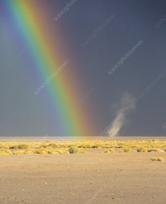 Rainbow and dust devil, Atacama, Chile