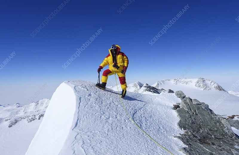 A climber on the summit of Mt Vinson