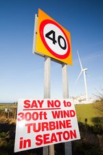 Protest sign about a new wind turbine