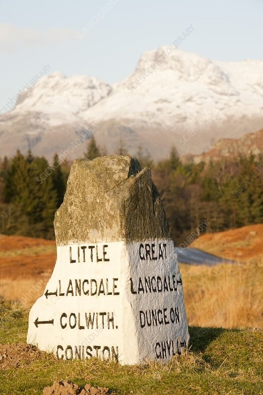 Old stone road sign in Langdale