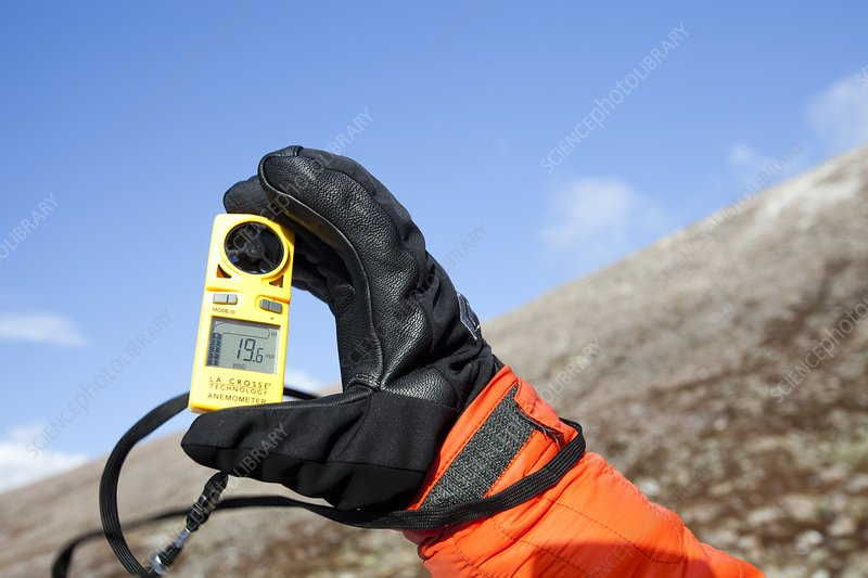 Mountaineer using an anemometer