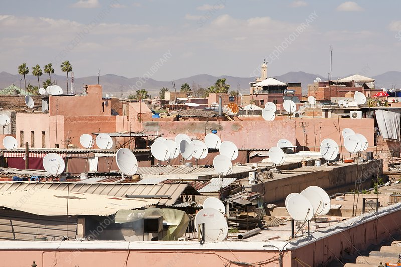 Satellite TV dishes on house, Morocco
