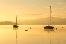 Sunrise over sailing boats