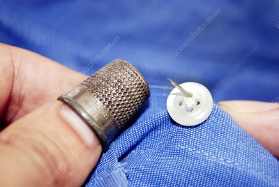 Stitching a button