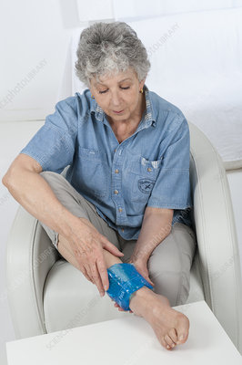 Older woman with swollen ankle