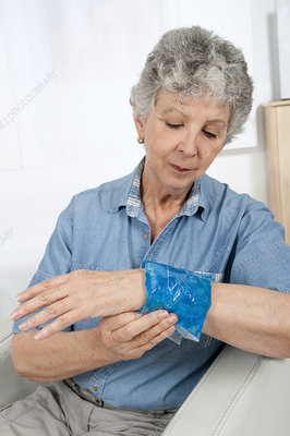 Older woman with swollen wrist