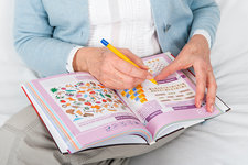 Older woman doing puzzles