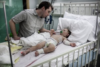 Father with baby son with pneumonia