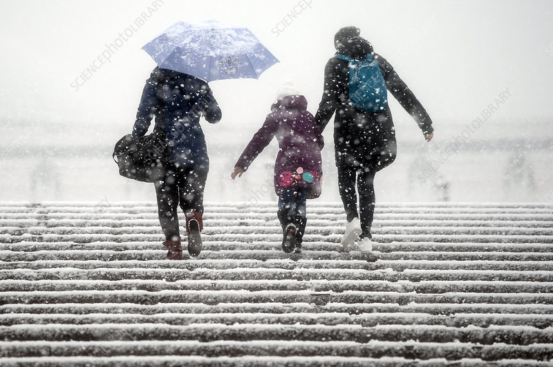 Family walking up snowy steps