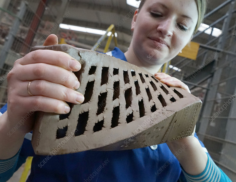 Worker with a clay brick