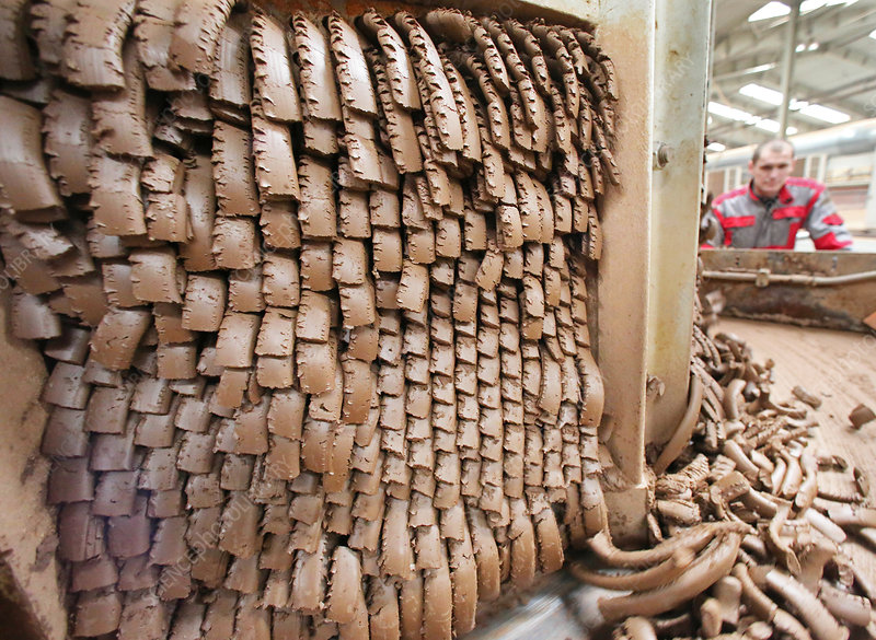 Clay extruded at a brick factory